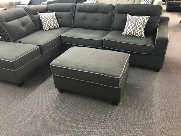 Grey charcoal linen rev sectional includes ottoman