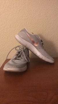pair of gray Nike low-top sneakers women's size 10 Houston, 77079