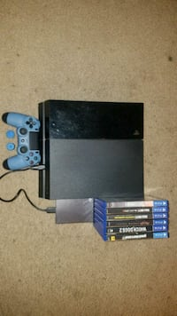 black Sony PS4 console with controller and game cases Huntington Park, 90255