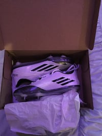 white-and-black adidas soccer cleats in box