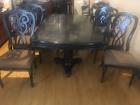 Black Dining room set with extensions and free chairs