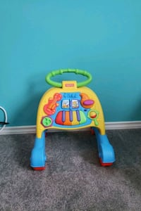 yellow and blue Fisher-Price learning walker.