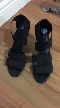pair of black suede open-toe ankle-strap heeled sandals