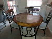 round brown wooden table with four chairs dining s Riverdale, 30274