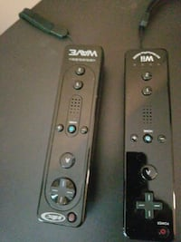 two black Nintendo Wii and Wave game controllers Atlanta, 30331
