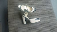 pair of white leather pointed-toe ankle strap heels Toronto, M5V 4A1