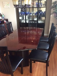 Rectangular brown wooden table with six chairs dining set Langley, V3A 3T3