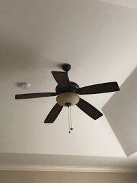 Ceiling fan with light fixture bronze and brown.