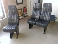 two black leather padded rolling armchairs Dallas, 75220