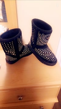 pair of round-studded black suede sheepskin snow boots Toronto, M6E 2W5