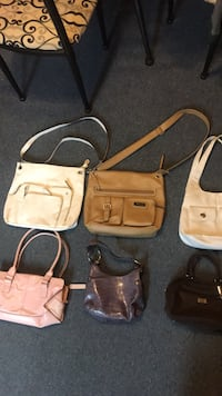 four assorted-color leather bags 538 mi