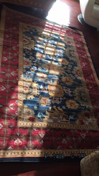 blue, red, and white floral area rug