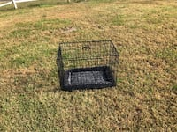 Small/medium dog cage brand new. We have never used it our dog grew to fast 81 km