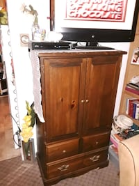 brown wooden TV hutch with flat screen television Chicago, 60603