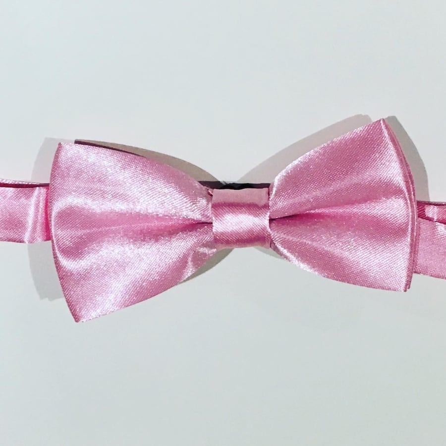 Adjustable men's and boys pink bow tie.