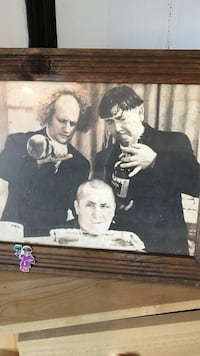 The three stoogies framed picture.