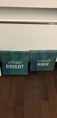 two blue Shine and Reach wall decor