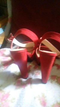 pair of red leather open-toe ankle strap heels Denver, 80215