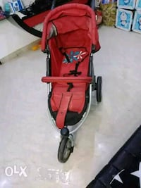 baby's red and black stroller New Delhi, 110027