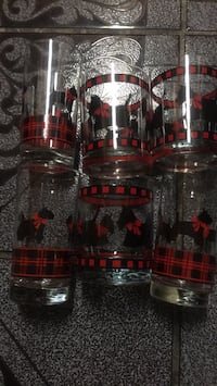 6 glasses with little dog on it clear trim with red and black