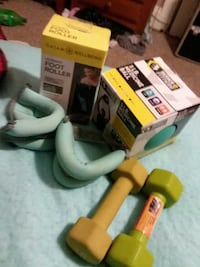 two yellow and gray dumbbells, foot roller, and medicine ball boxes East Providence, 02916