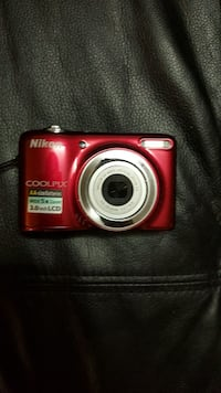 red Nikon Coolpix point-and-shoot camera