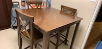 Rectangular brown wooden table with four chairs dining set Toronto, M9P 3R1