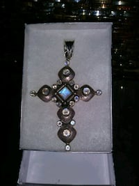 silver-colored beaded cross Sun City