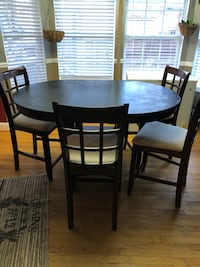 round brown wooden table with four chairs dining set Duncan, 29334