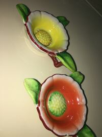 two yellow-red-green ceramic floral vases