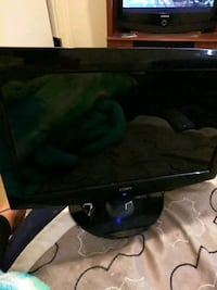 black LG flat screen TV Victorville, 92395