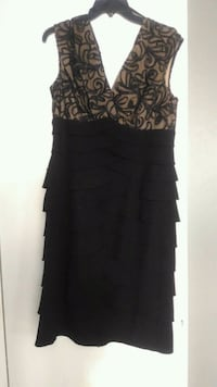 Woman black dress Winter Haven, 33880