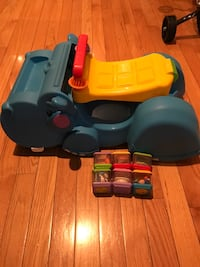 Obo blue, red, and yellow hippopotamus plastic ride-on toy