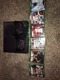 black Xbox One with controllers and game cases Saint George, 84770
