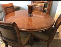 round brown wooden table with four chairs dining set San Diego, 92037