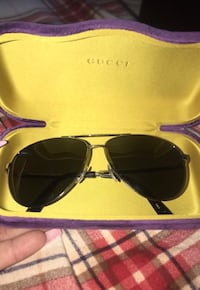 Silver framed Gucci aviator sunglasses 2403 mi