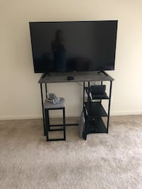 black flat screen TV; black wooden TV stand Towson, 21286