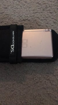 Portable Game Console (Includes original charger and car charger)