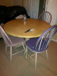 round brown wooden table with four chairs dining s 1370 mi