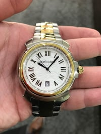 round gold and white analog watch with gold and silver link bracelet Toronto, M5R 1A6