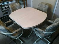 oval brown wooden table with four chairs Fort Saskatchewan, T8L 0B9
