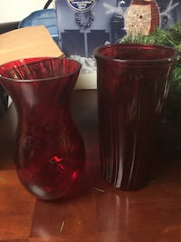 two red glass vases