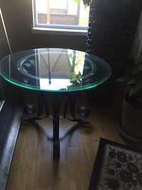 round glass top table with black wooden base VANCOUVER