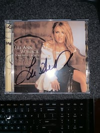 Lee Ann Womack autographed CD with original concert tickets.