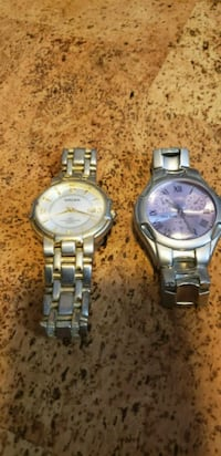 two round silver analog watches 25 mi