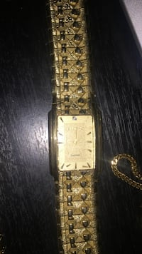 square gold-colored analog watch with link bracelet Lower Sackville, B4E 2W8