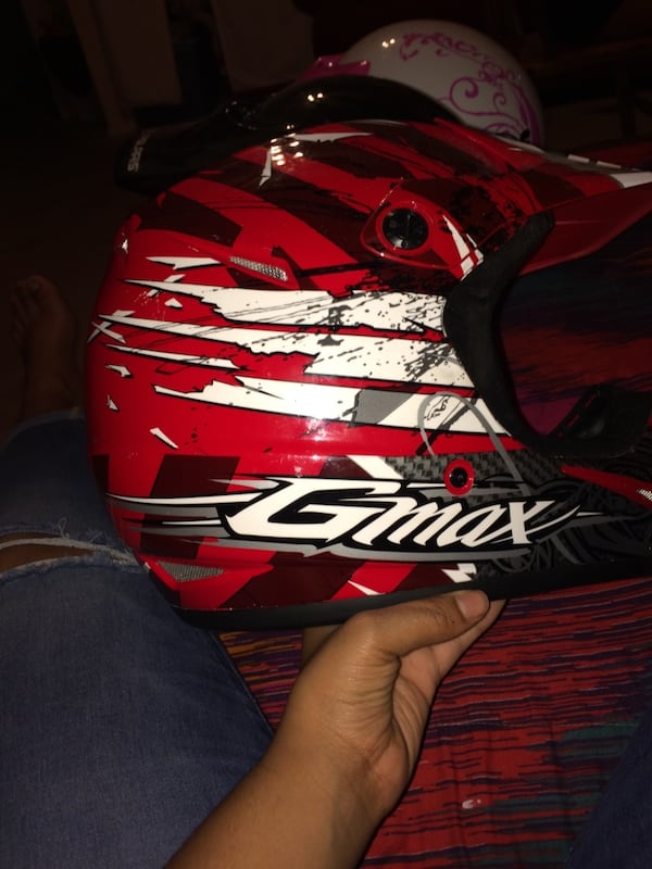 Red and white Gmax dirt bike helmet d51583f5-34d5-4e4a-a387-49f451580d52