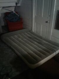 white and brown wooden bed frame