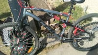 black and red full suspension mountain bike Edmonton, T5X 3V9