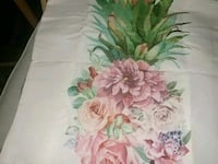 white, pink, and green floral textile Montreal, H8T